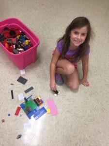 child with Legos