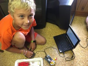 child with their laptop