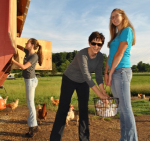 Graduate of 2015 NC Farm School with her daughters.