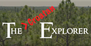 "Photo of the Titles for The Croatan Explorer video series. Photo is a still of pine trees in the Croatan Forest with the words ""The Croatan Explorer"" in white and red."